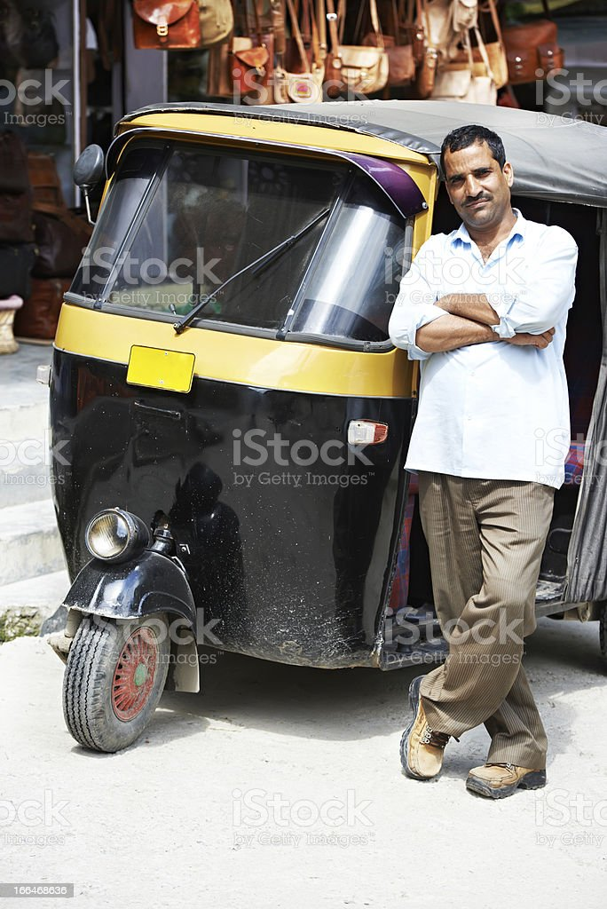 Indian auto rickshaw tut-tuk driver man royalty-free stock photo