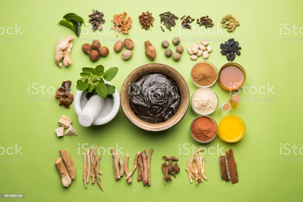 Indian Ayurvedic dietary supplement called Chyawanprash / chyavanaprasha  is a cooked mixture of sugar, honey, ghee, Indian Gooseberry (amla), jam, sesame oil, berries, herbs and various spices stock photo