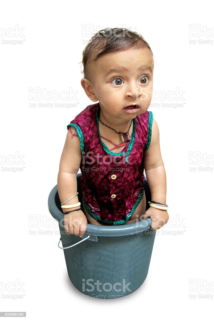 Indian Baby Having Bath In The Bucket Stock Photo & More Pictures of ...