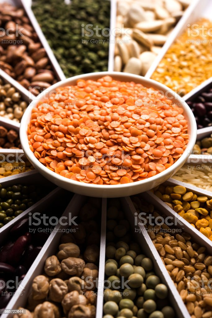 Indian Beanspulseslentilsrice And Wheat Grain In A White Sunburst Or Sun  Rays Shape Designer Container Selective Focus Stock Photo - Download Image