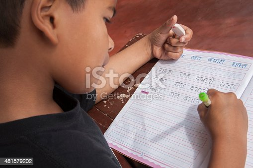 941782244 istock photo Indian boy from the Khasi tribe practicing Hindi handwriting. School. 481579202