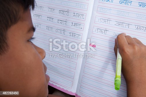 941782244 istock photo Indian boy from the Khasi tribe practicing Hindi handwriting. School. 482263450