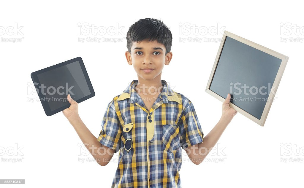 Indian Boy Holding Tablet and Slate stock photo