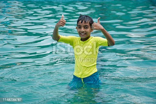 Indian boy enjoy summer vacation  at water park