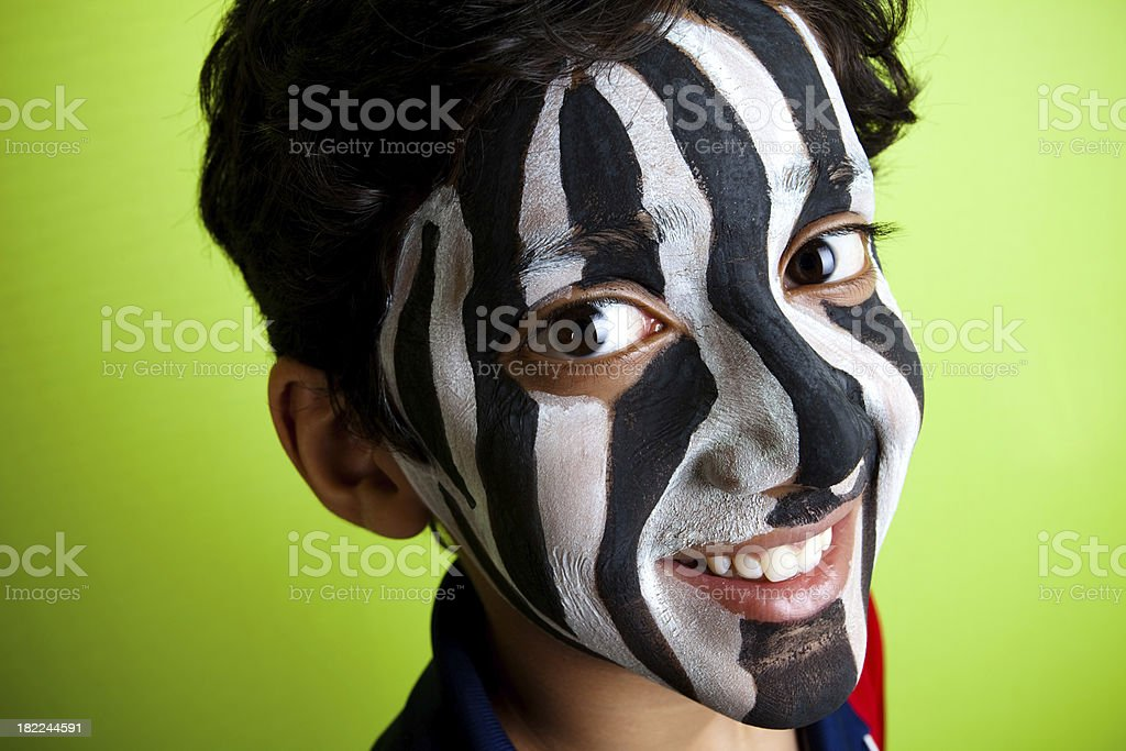 Indian Boy wearing a Zebra Strips on his face royalty-free stock photo