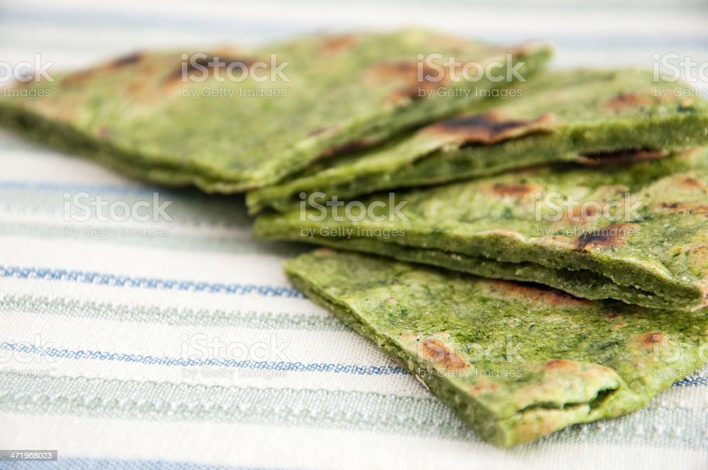 Indian bread naan with spinach stock photo
