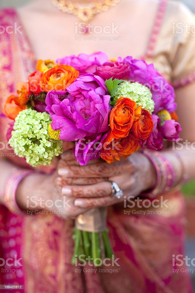 Indian bride with bright bouquet stock photo
