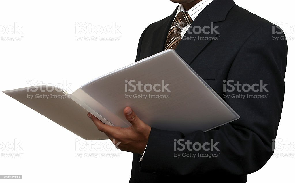 Indian business man looking at a file royalty free stockfoto