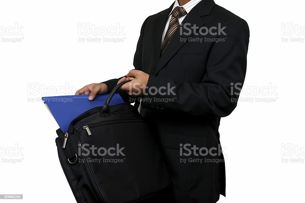 Indian business man taking out a file. royalty-free stock photo