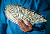 istock Indian Businessman Holding Indian Currency 1171982805