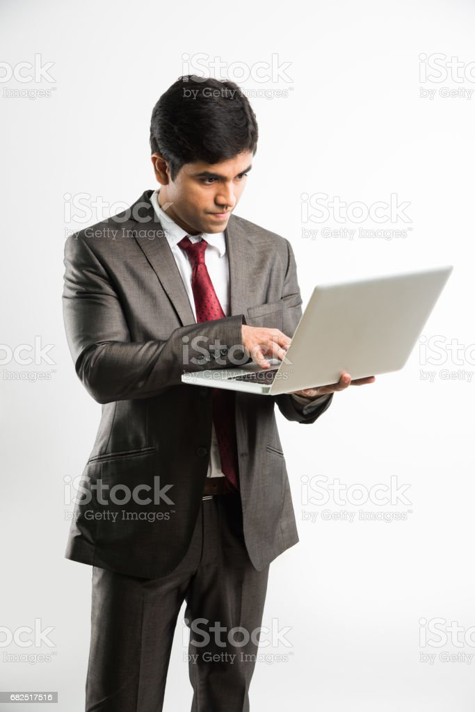 indian businessman holding laptop over white background and looking upward towards camera, a view from top also known as bird's eye view Lizenzfreies stock-foto