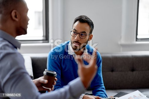 1031394390 istock photo Indian businessman leading a team of creative millenials collaborating on a brainstorm project 1168662425