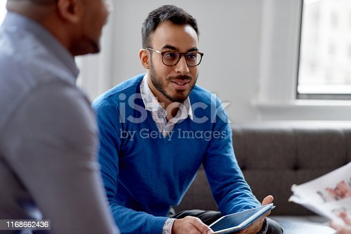 1031394390 istock photo Indian businessman leading a team of creative millenials collaborating on a brainstorm project 1168662436