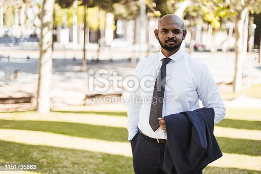 istock indian businessman portrait 1151795663