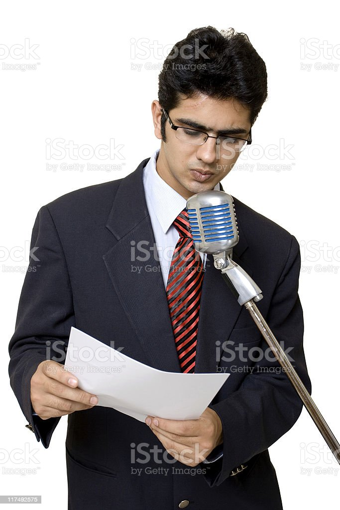 Indian Businessman Public Speaker Speech Isolated On White with Microphone royalty-free stock photo