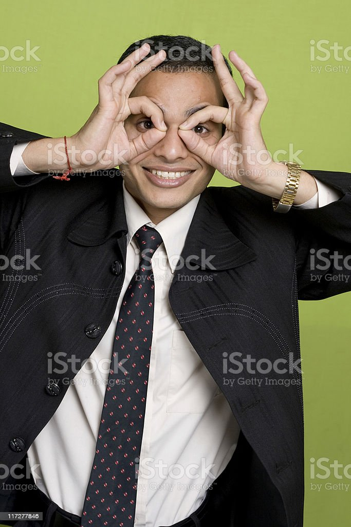 Indian Businessman Searching for solutions making binoculars with his hands royalty-free stock photo