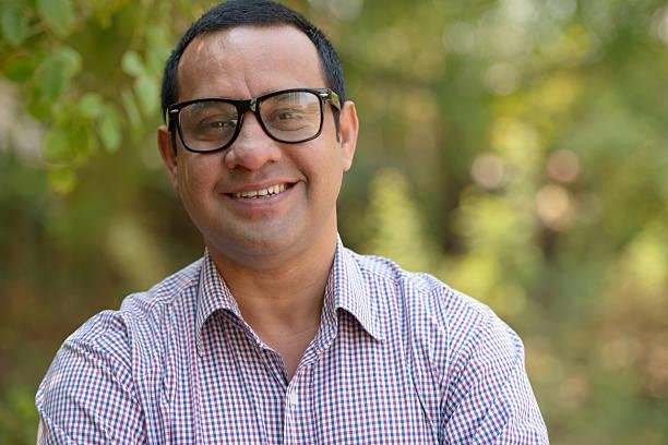 Indian businessman smiling outdoors - foto de acervo