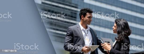 Indian businessman talking with businesswoman outdoors picture id1166716416?b=1&k=6&m=1166716416&s=612x612&h=okvf6ro2zohcdqruhr 2qkogkqjbj6r4d9f1rrqogqa=