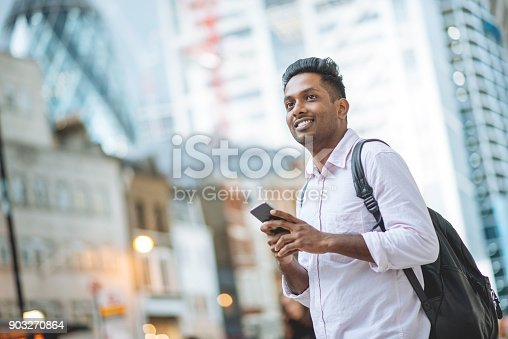 istock Indian businessman using mobile app to call taxi 903270864