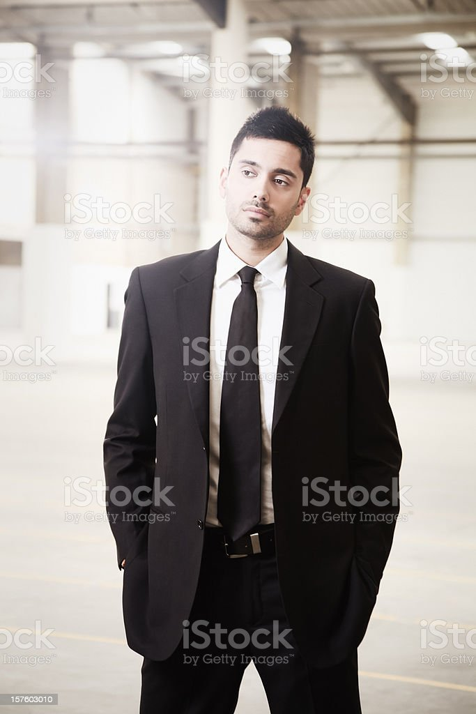 Indian businessman with Industrial background royalty-free stock photo