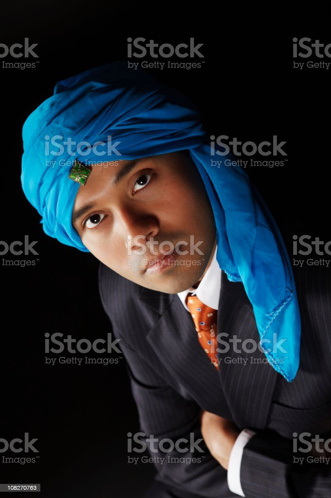 Indian businessman with intense eyes wearing a turquoise pagdi (turban) royalty-free stock photo
