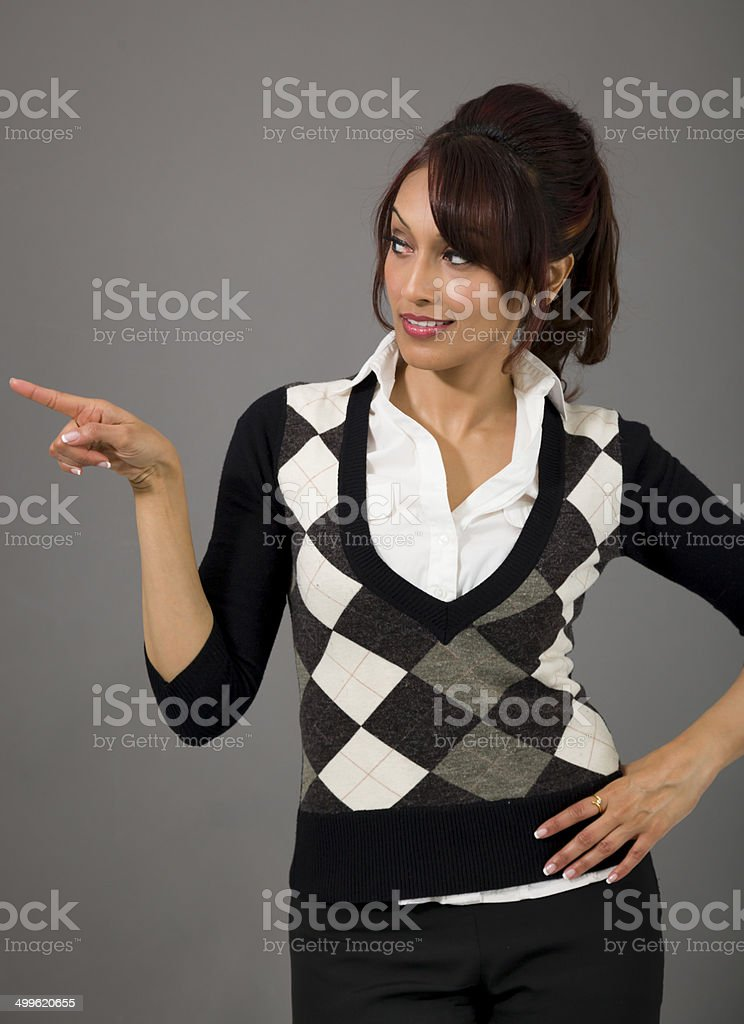 Indian businesswoman pointing sideways royalty-free stock photo