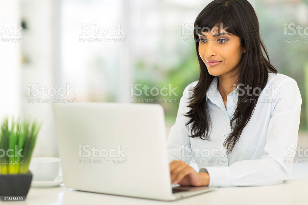 indian businesswoman using computer stock photo