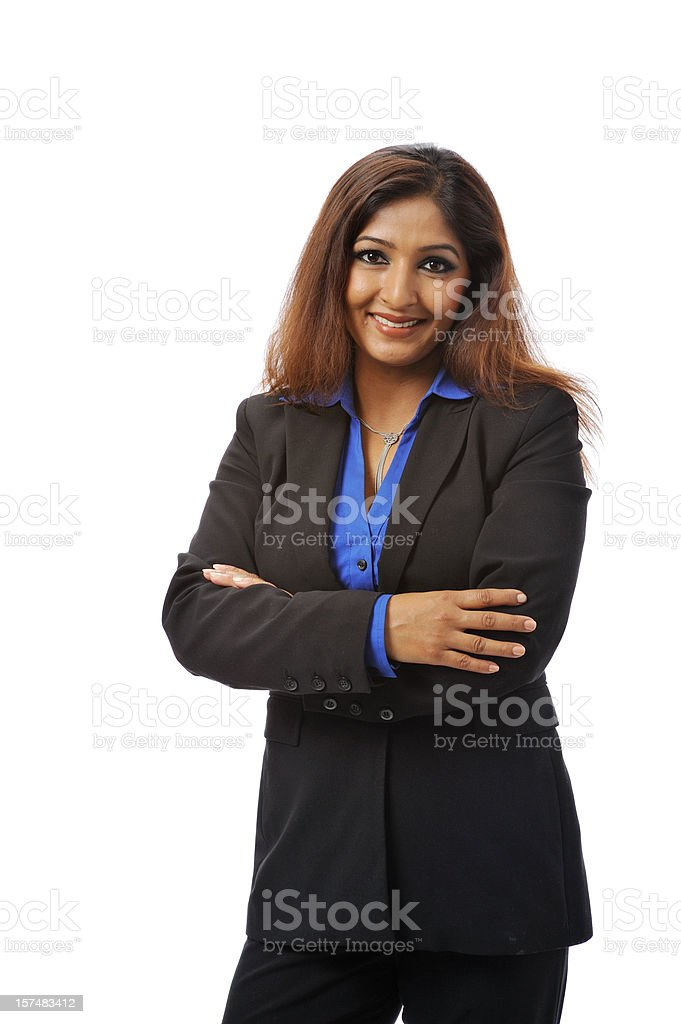 Indian businesswoman with her arms crossed and smiling royalty-free stock photo