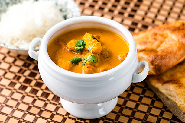 Indian Butter Chicken Curry Dish with Naan Bread Butter Chicken dish, an Indian curry dish with basmati rice and naan bread on the side. butter chicken stock pictures, royalty-free photos & images