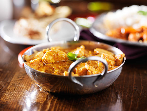 indian butter chicken curry with basmati rice indian butter chicken curry with basmati rice in balti dish with naan in background balti dish stock pictures, royalty-free photos & images