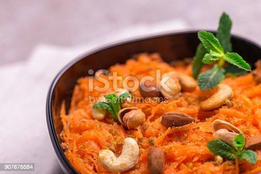 909460438 istock photo Indian carrot Gajar halwa. Copyspace, horizontal view, flatlay. 907676584