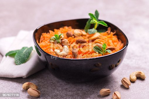 909460438 istock photo Indian carrot Gajar halwa. Copyspace, horizontal view, flatlay. 907677116