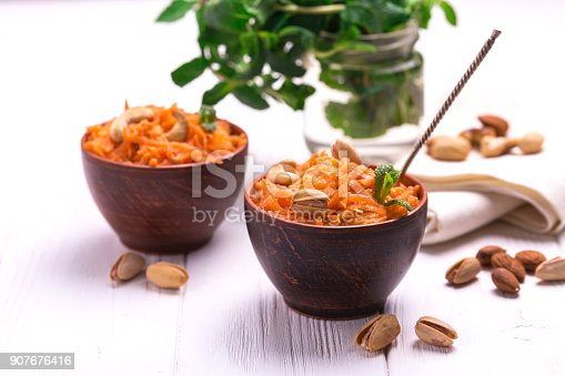 909460438 istock photo Indian carrot Gajar halwa. Copyspace, horizontal view. 907676416