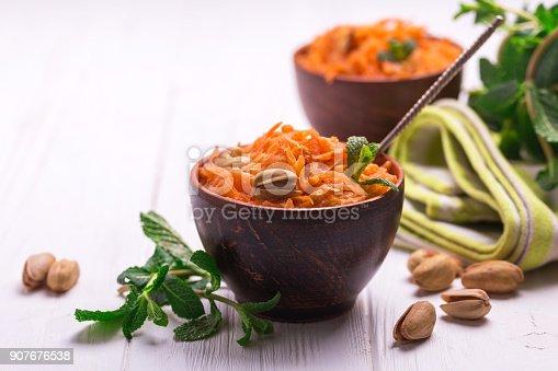 909460438 istock photo Indian carrot Gajar halwa. Copyspace, horizontal view. 907676538