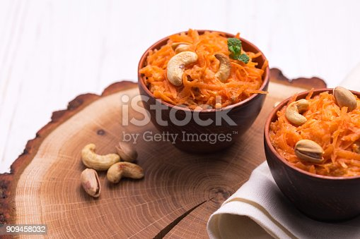 909460438 istock photo Indian carrot Gajar halwa. Copyspace, horizontal view. 909458032