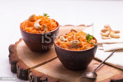 istock Indian carrot Gajar halwa. Copyspace, horizontal view. 909460438