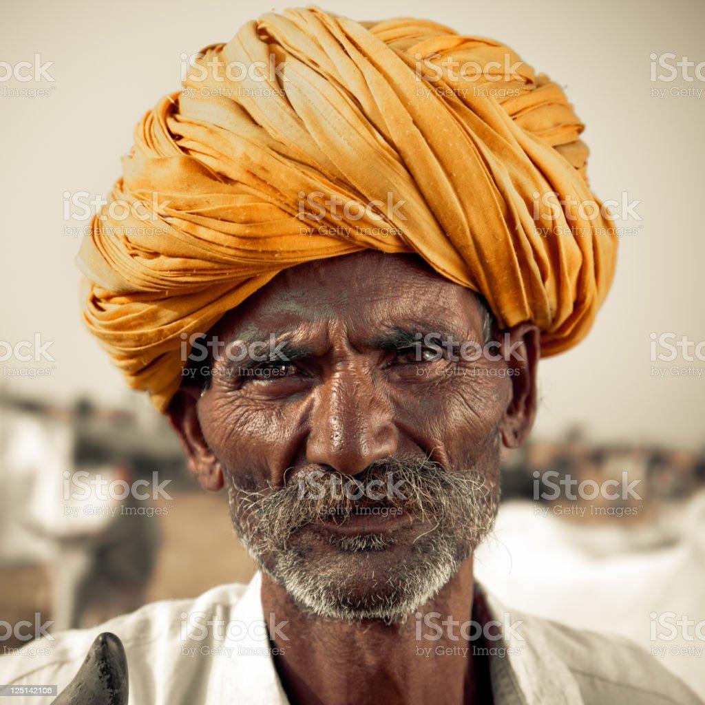 Portrait of an indian cattle merchant at the Pushkar Camel Fair,...