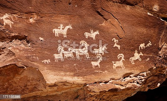 19th century indian petroglyph art photographed on public land in Southern Utah.