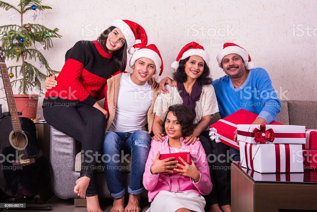 indian celebrating christmas with gift boxes royalty free stock photo