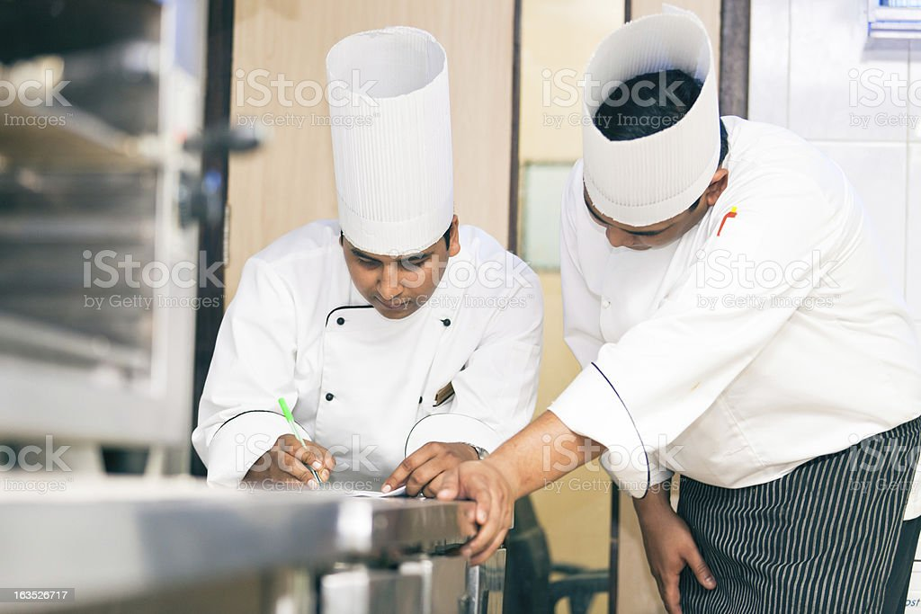 indian chefs planning the menu stock photo