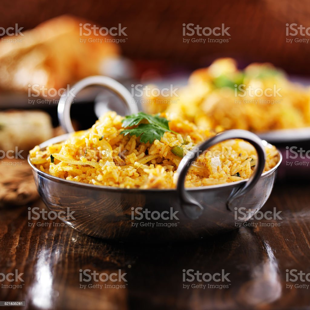 indian chicken biryana in balti dish stock photo