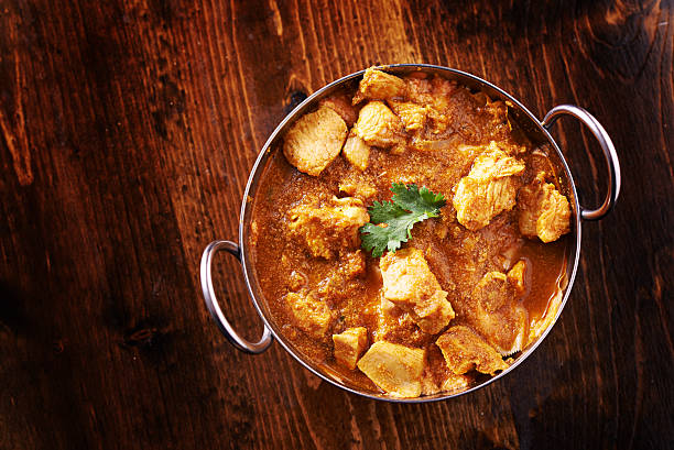 indian chicken curry in balti dish overhead photo overhead photo of a batli dish with indian butter chicken curry balti dish stock pictures, royalty-free photos & images