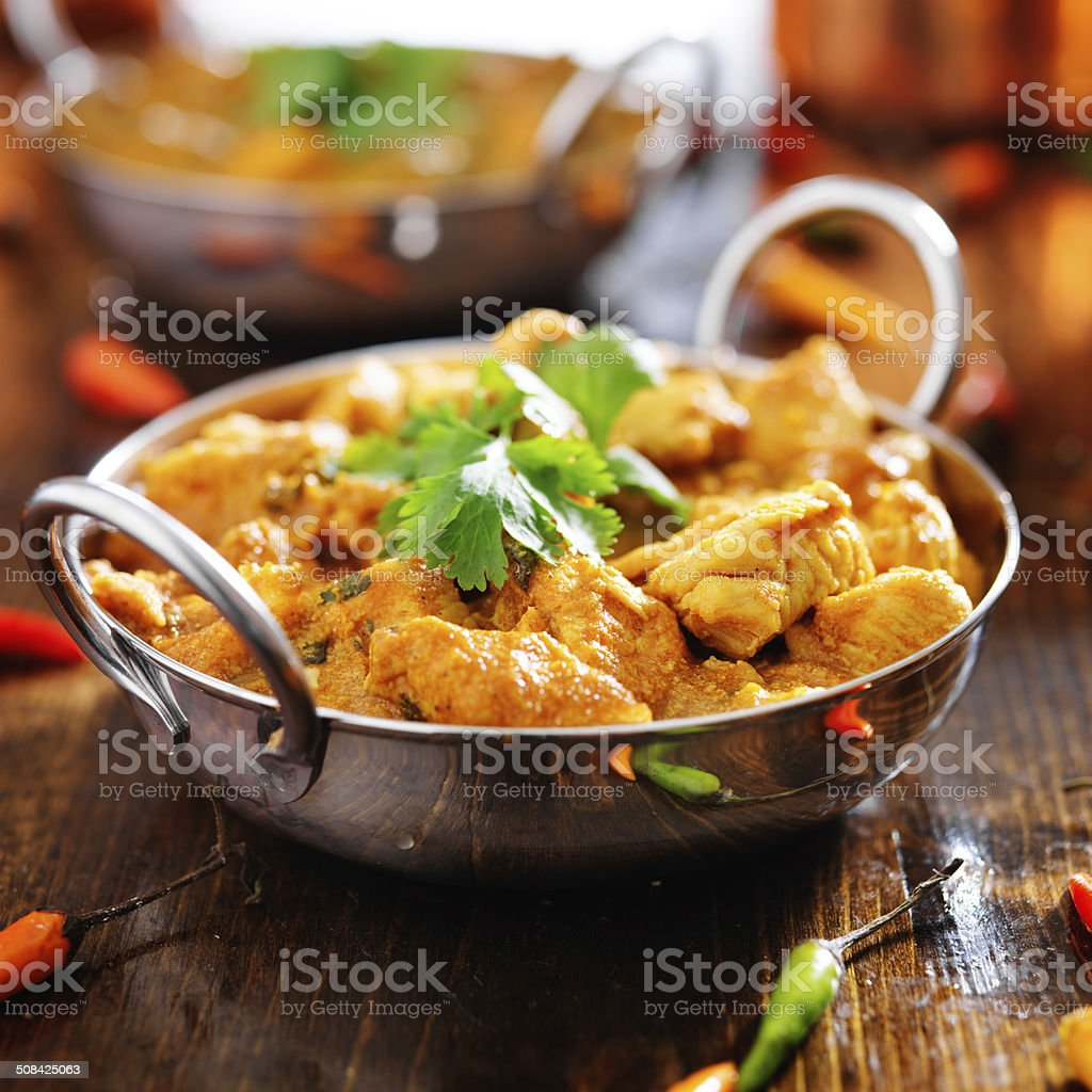 indian chicken curry in balti dish stock photo