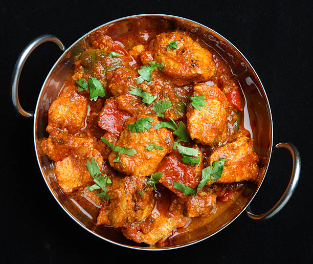 Indian Chicken Jalfrezi Curry Indian chicken jalfrezi curry in a balti dish. balti dish stock pictures, royalty-free photos & images