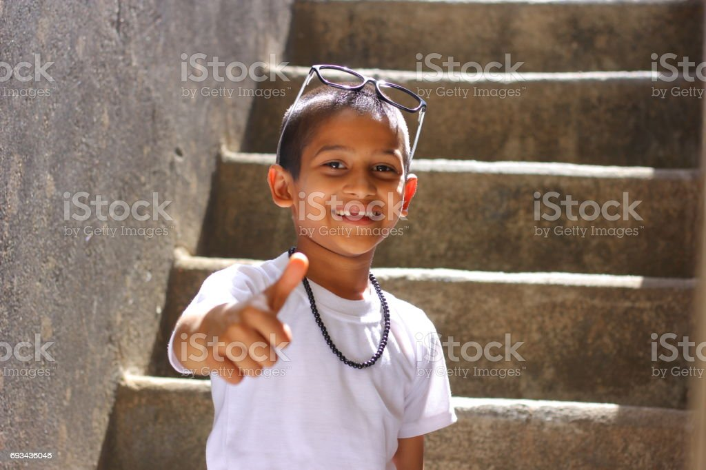 Indian child showing thumps stock photo