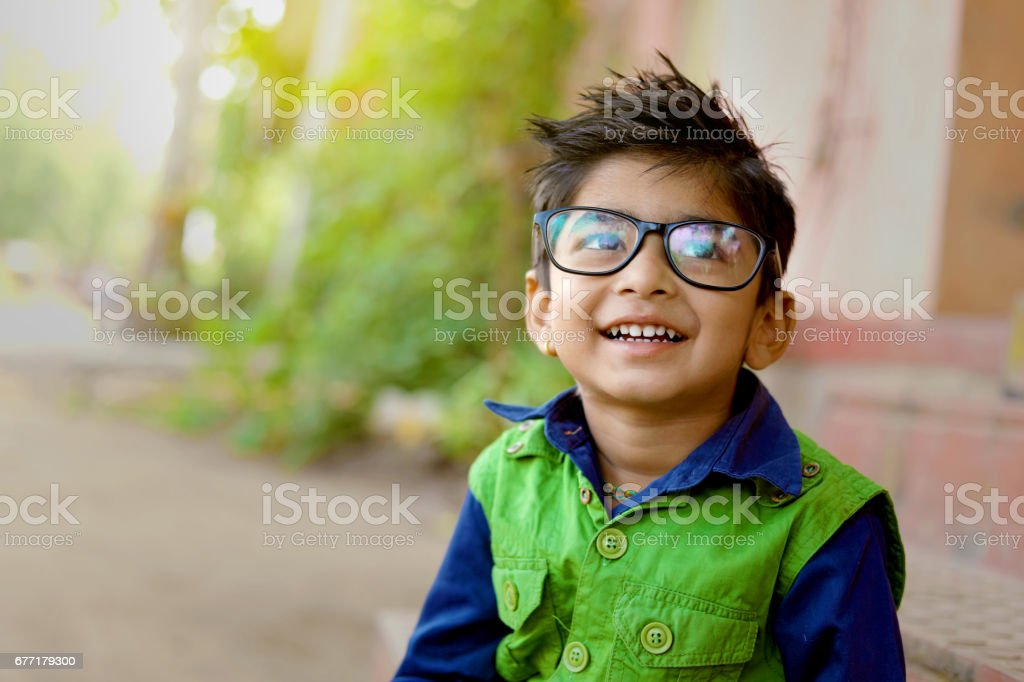 Indian child wear eyeglass stock photo