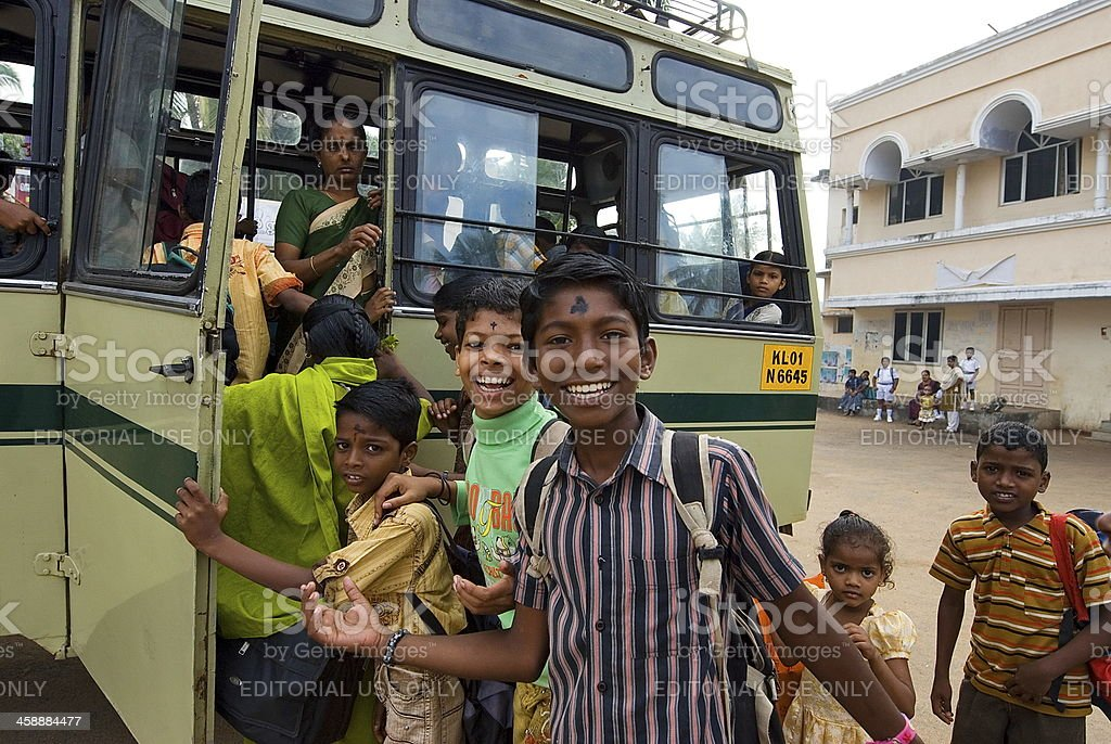 Indian children get on a school bus. royalty-free stock photo