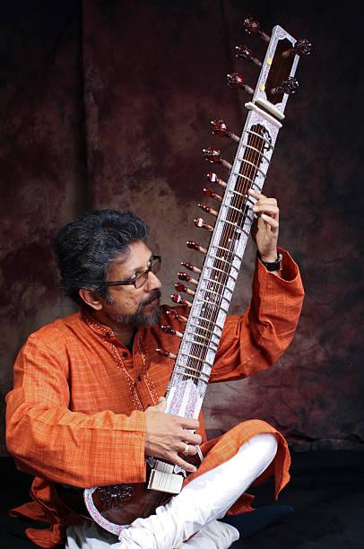 https://media.istockphoto.com/photos/indian-classical-music-sitar-picture-id140091632?k=6&m=140091632&s=612x612&w=0&h=p4uunzm1mkpyURXErRWA_7sNQnGziZpydyUTsJRrX0U=