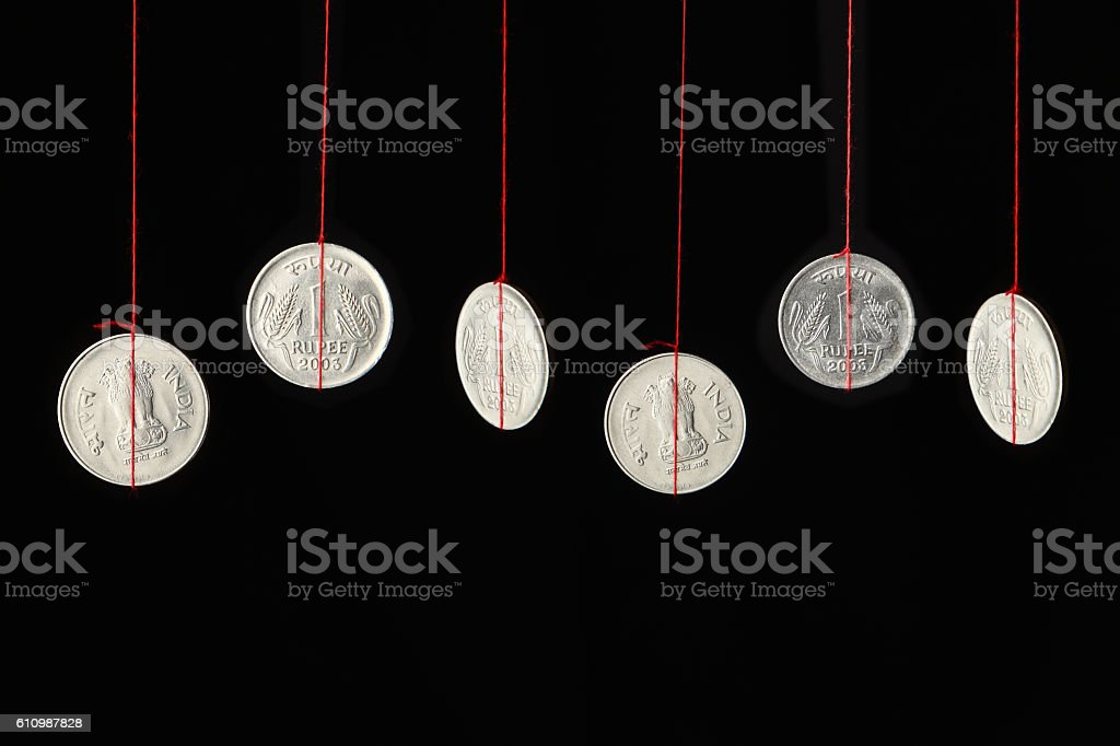 Indian coins hanging on strings stock photo