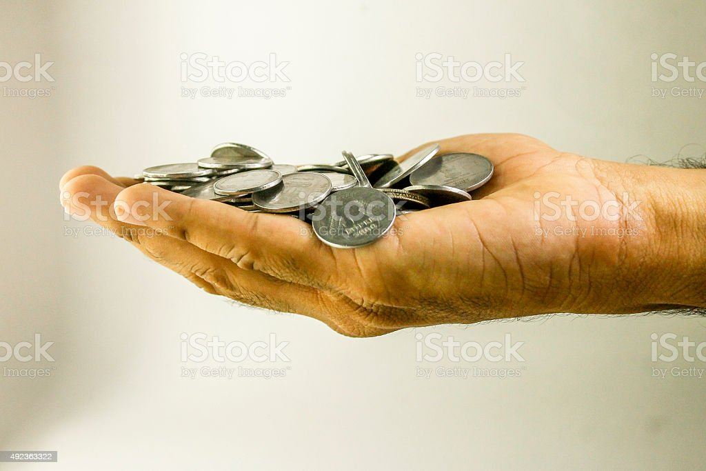 Indian coins heap on palm. stock photo